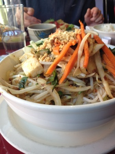 Vermicelli Bowl with steamed tofu, Vietnamese pickles, lettuce, carrots, peanuts in a spicy & smoky lemongrass sauce.